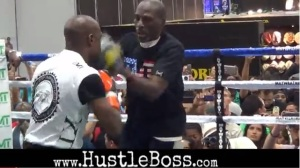 Floyd Mayweather on the mitts with Uncle Roger at MAGIC Market Week inside of the Mandalay Bay