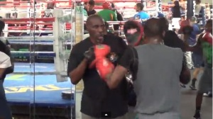Roger and Jeff Mayweather padwork at the Mayweather Boxing Club